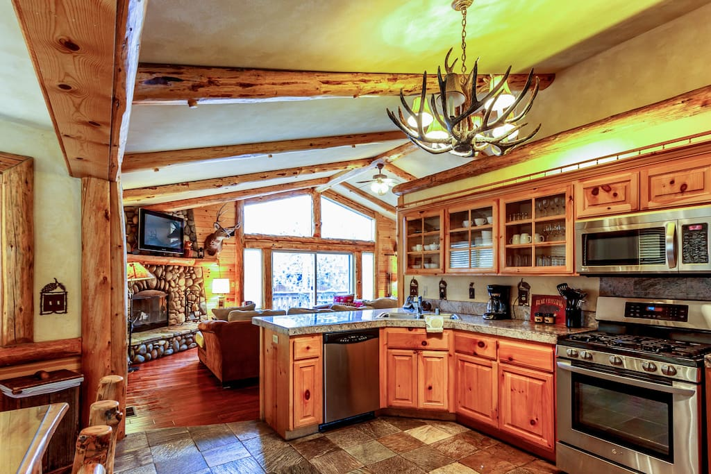 Front entry through the kitchen, with 6 person log dining set