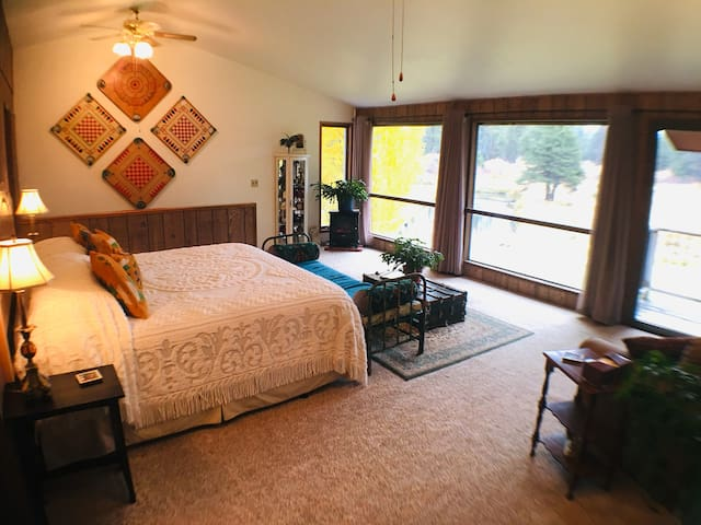 Watch the stars from bed, watch the sunrise too!  One King Bed upstairs. One Queen Hideabed downstairs.  A bonus Single Hideabed loveseat upstairs.  Sleeps up to 4.  The electric fireplace is located in the corner of this photo.