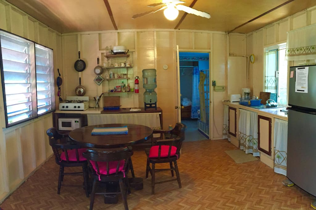 Kitchen and dining end.  Just a hint of pink!