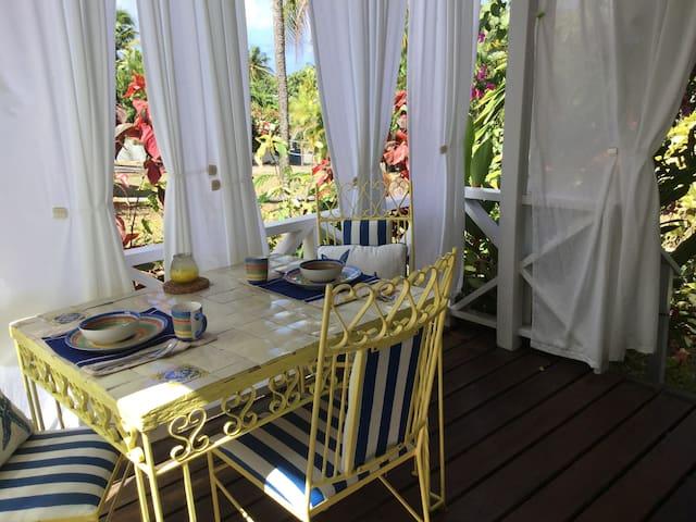 Verandah overlooking the garden for a morning coffee.