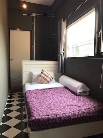 Comfy single bed with bathroom perfect for solo traveller.