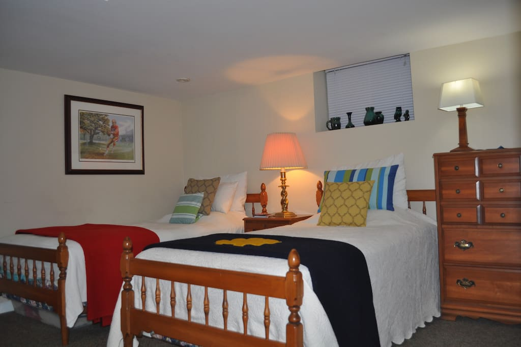 Spacious bedroom with two single beds, another view