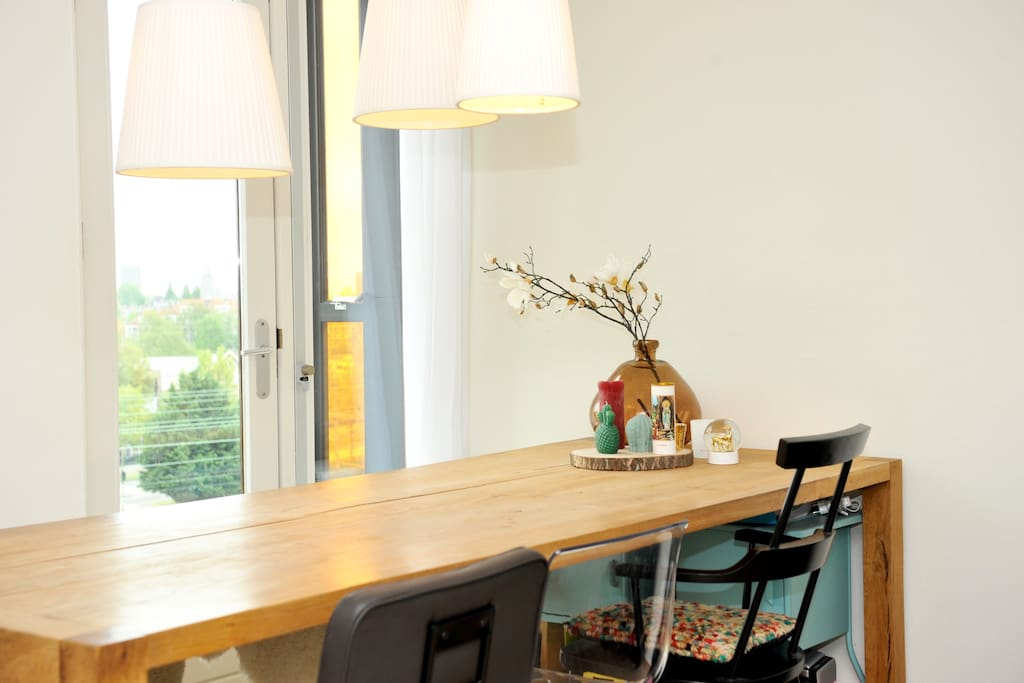 Bright dining room with table and a nice view
