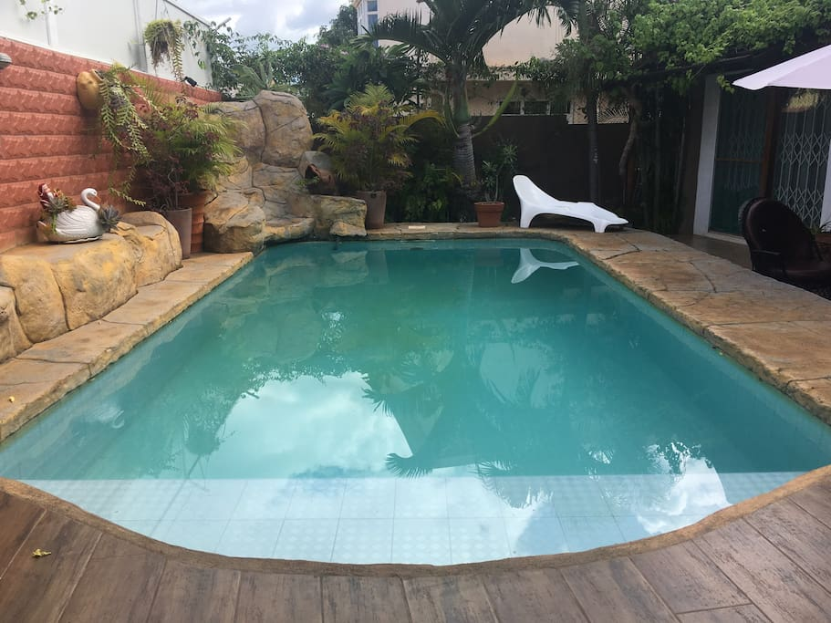 The pool in the backyard accessible to the guest.
