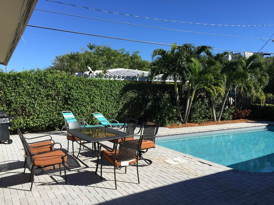Plenty of comfortable seating for dining outside and laying out by the pool.