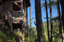 Treehouse detached private hot tub building.
