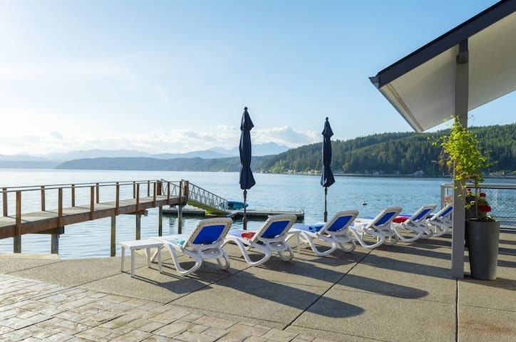 Walls of Glass Hood Canal Vacation Rental: Sun chairs with beach towels, umbrellas, dock with kayaks and paddle boards.