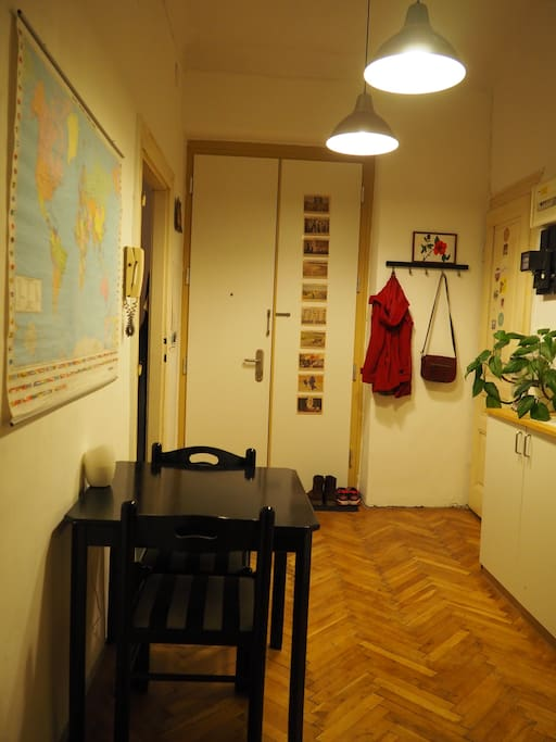 Vestibule with world map and a second table