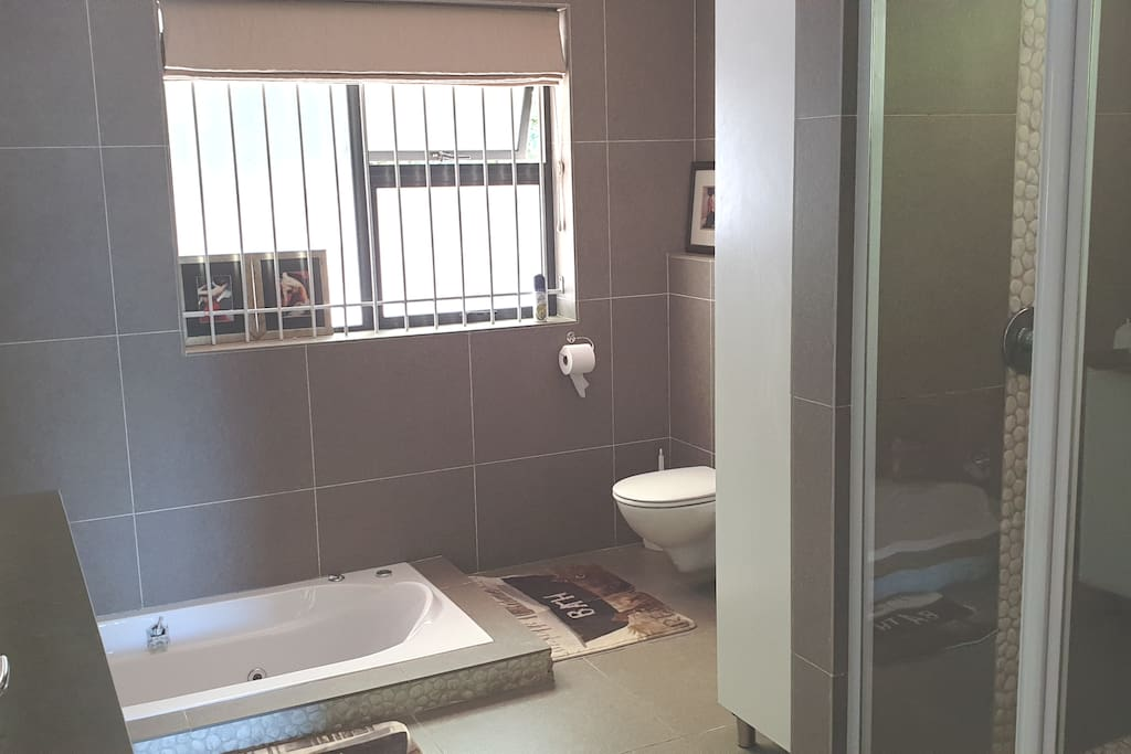 Main ensuite with double shower and bath with jets