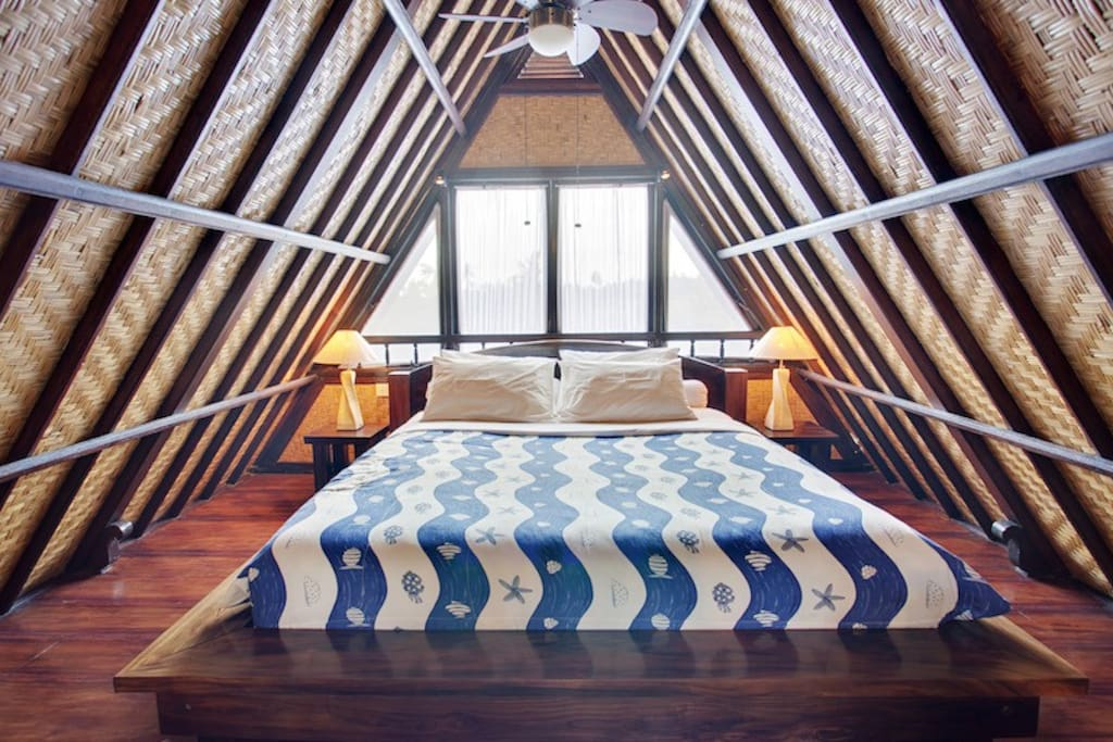 The funky Lumbung inspired Balinese bedroom on the second story of your villa