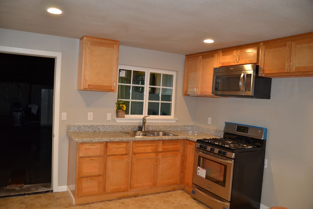 Kitchen with stainless steel double sink and appliances