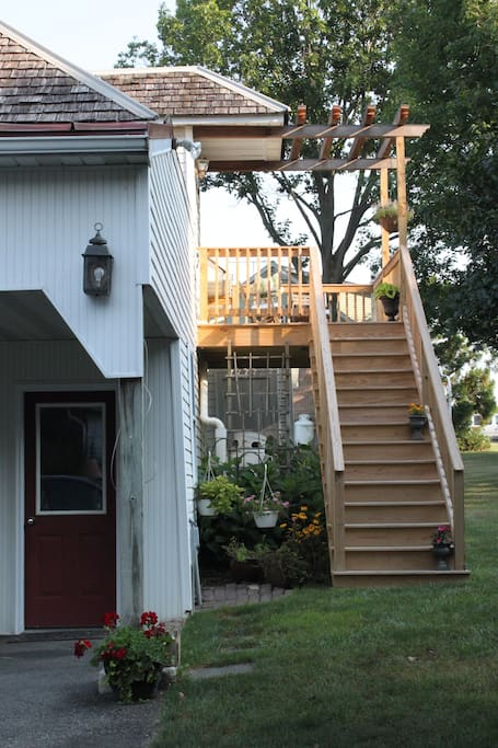 View up the stairs to the deck and entrance to the Loft.