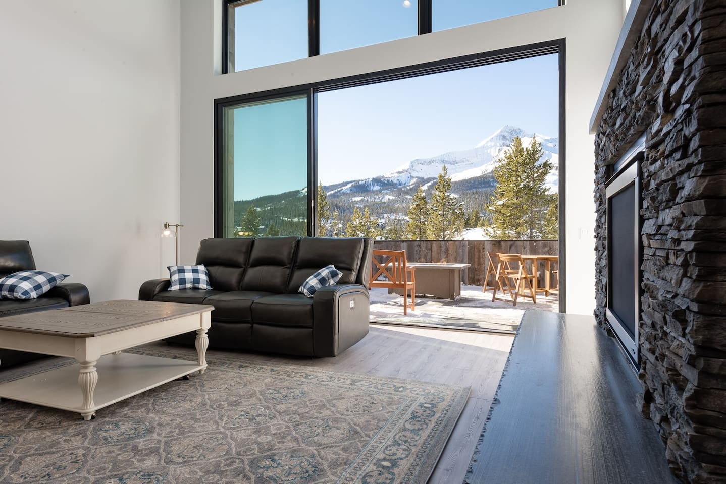 Living room with direct view of Lone Mountain and 15' sliding glass doors to open patio.