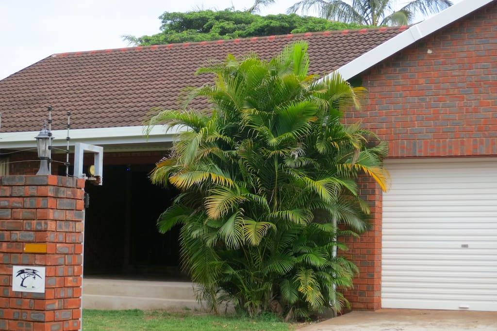 Front of the property has 2 double garages and is secured by a wall with an electric fence. There are also security beams and slam lock doors.