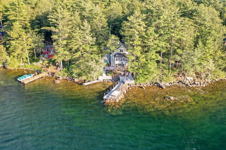 Lovely waterfront home on Lake Winnipesaukee with 24' boat dock and fire-pit.