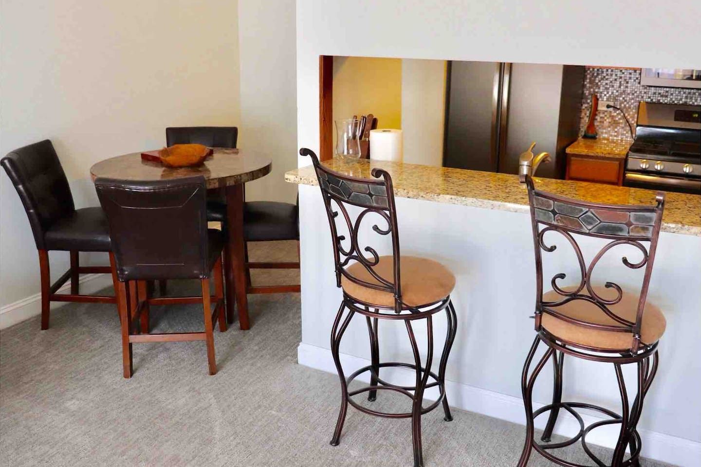 The dining room and kitchen view from the living room.