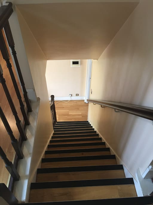 The stairs from living room to the bedroom