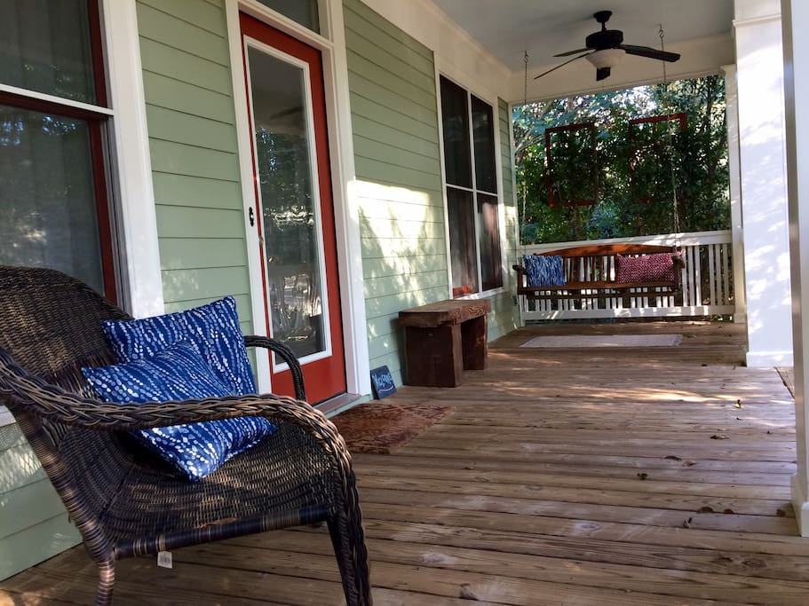 Spacious front porch with great views...wooded surroundings and downtown at your doorstep.