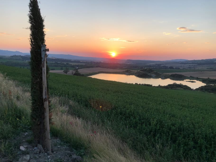 Romantic sunset view from the guesthouse over the Val d'Orcia