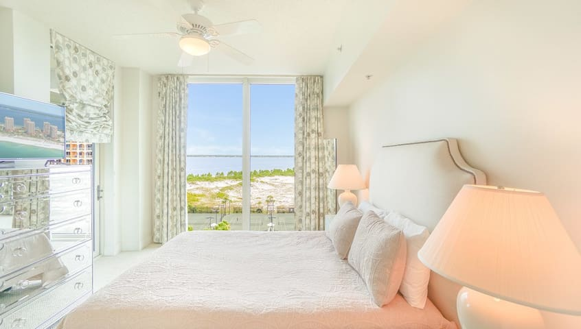 Cozy second bedroom with views over our 5 Hydro Clay Tennis courts and the beautiful Sana Rosa Sound.