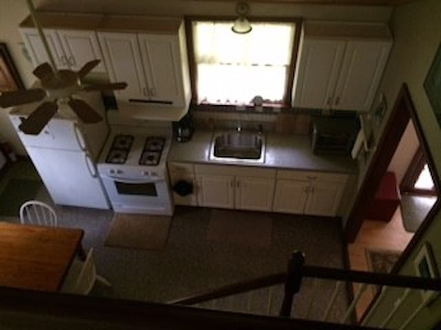 view of kitchen from upstairs bedroom