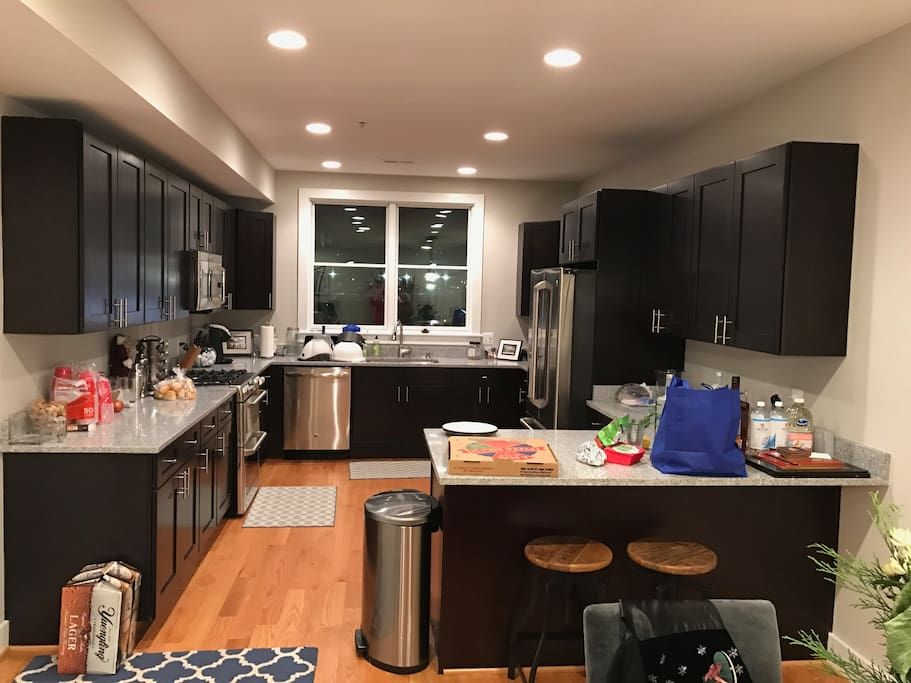 Gourmet kitchen features a conventional, convection, and microwave oven, six burner cooktop, wine fridge state of the art GE fridge, and breakfast bar.