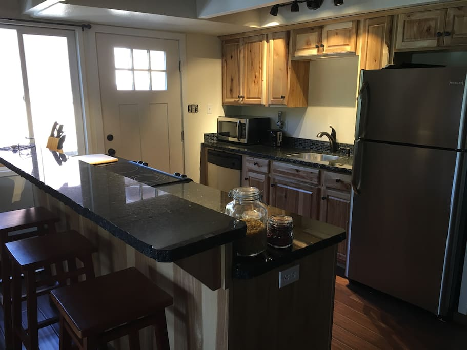 Fully remodeled kitchen with granite counters.