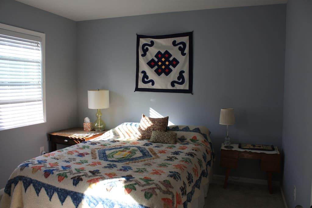 Queen bedroom in morning