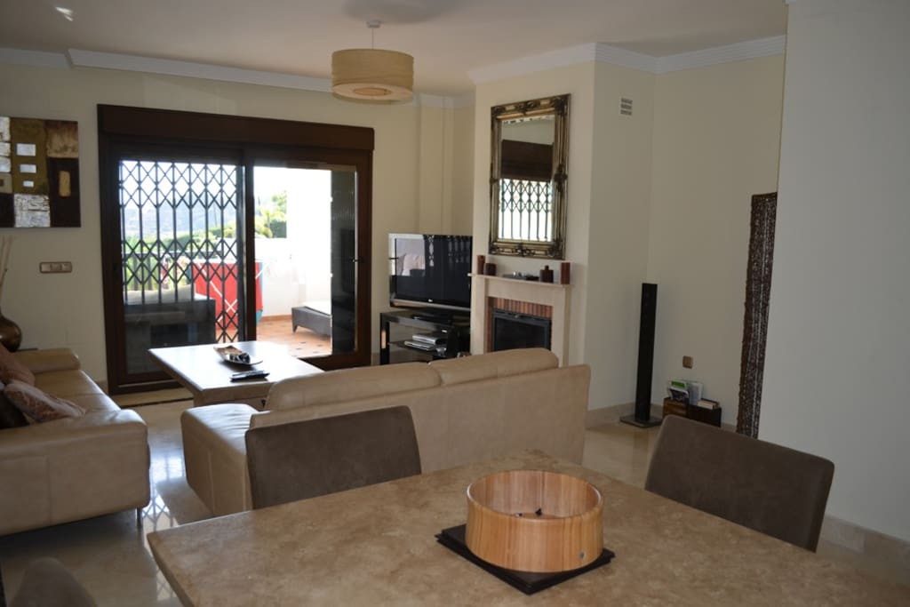 Large 3 seat sofa, 1 large double sofa and large dining table in main living area.