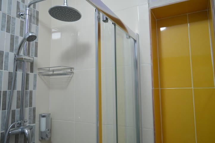 Private bathroom with rain shower