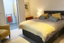 Comfortable king size bed, cosy room and walk in ensuite shower room. TV, Wifi and use of a small kitchenette for BNB guests. Separate from the main house. Ample free parking.