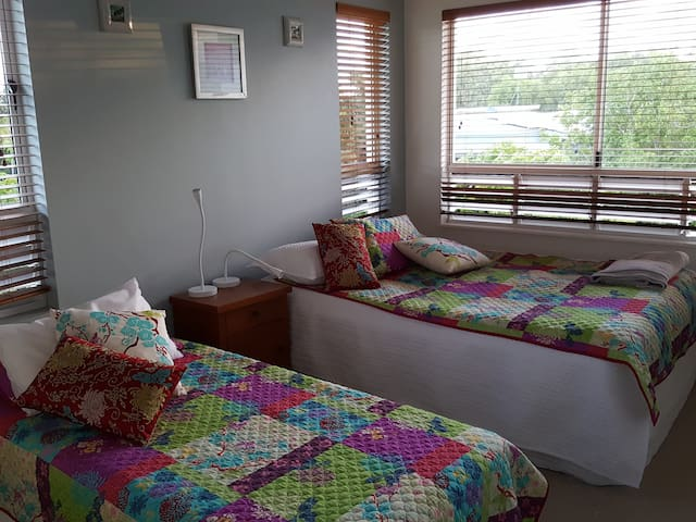 2nd bedroom with 1 Queen and 1 Single bed. This bedroom has an en-suite.