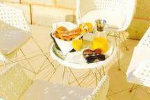 Breakfast on The terrace.  -  Petit déjeuner sur la terrasse
