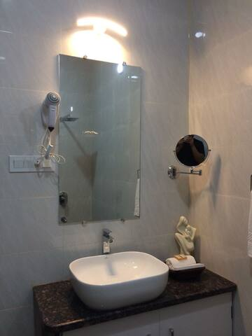 Clean, large and luxurious bathrooms with Hair Dryer and Shaving Mirror