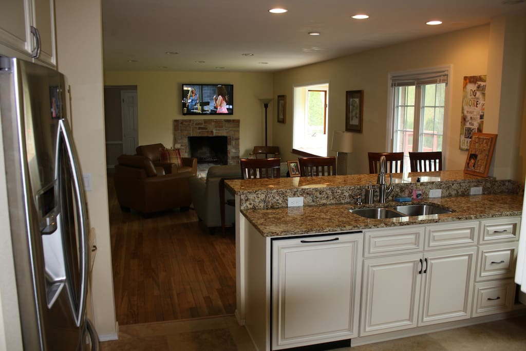 Kitchen / Family Room with Natural Fireplace