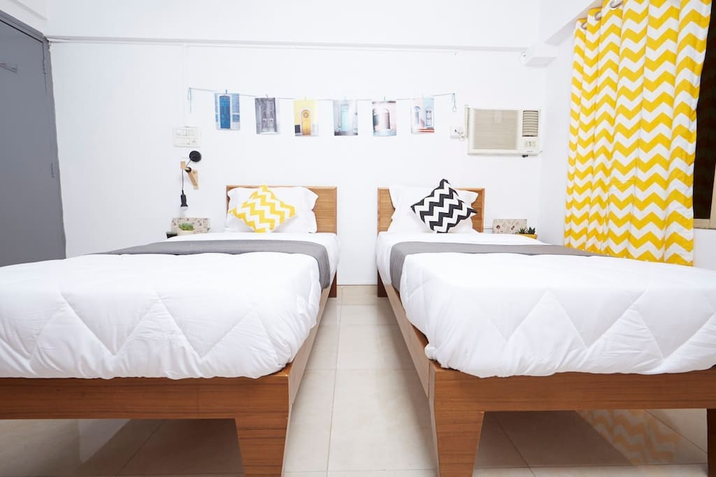 Room 1 with 2 sturdy Single beds, Orthopedic mattresses and Dr. Back pillows for an incredibly restful sleeping experience.