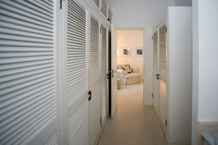 View of Ginger bedroom from walk in closet / walkway to ensuite and vanity area.