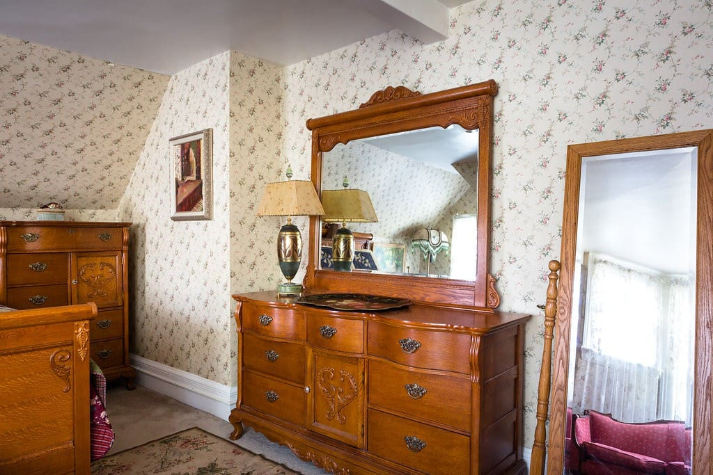 The Master contains a beautiful Lexington bedroom suite with this triple dresser