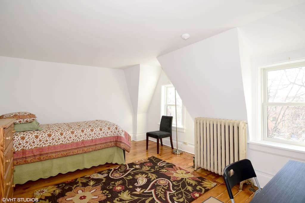 Spacious front bedroom with lots of natural light and a desk to work at