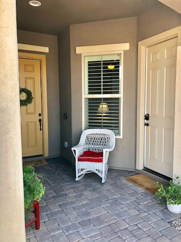 The tan door is your private entrance. Let yourself in using the keypad.