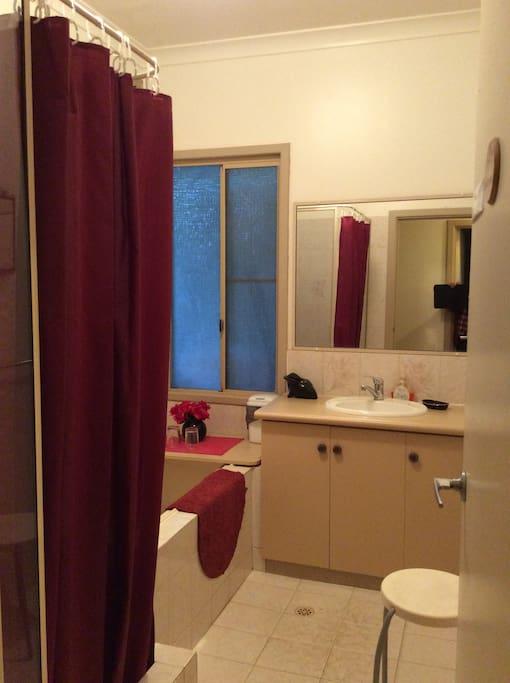 Maroon bathroom.