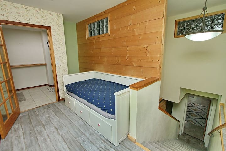Twin bed in the nook going down stairs.