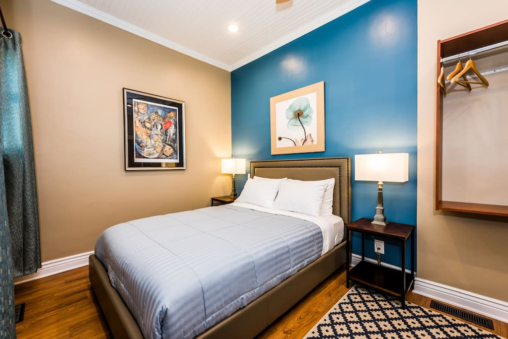 Sycamore Guesthouse, Three Oaks, MI. Room 2 - First Floor: features a queen luxury plush mattress set, quality linens, wall-mount TV & cable, WiFi, Central A/C, closet organizer/storage, swivel chair, bedside lamps, dressing mirror and fully equipped private ensuite bathroom.
