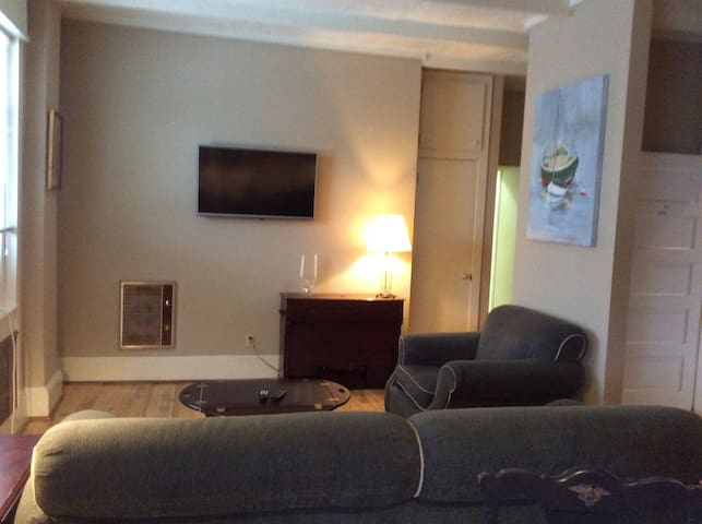 Den with Flat Screen TV with cable and internet.