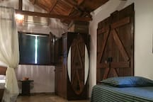 Bedroom 1 - The wardrobe, the mirror and one of the two wooden doors