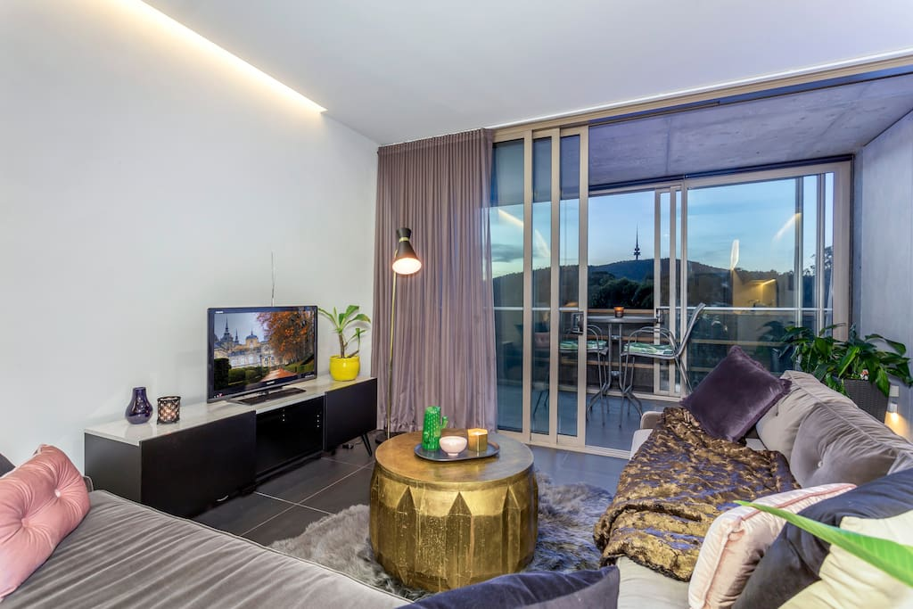 Living room with breathtaking views of Black Mountain and the iconic Telstra Tower.