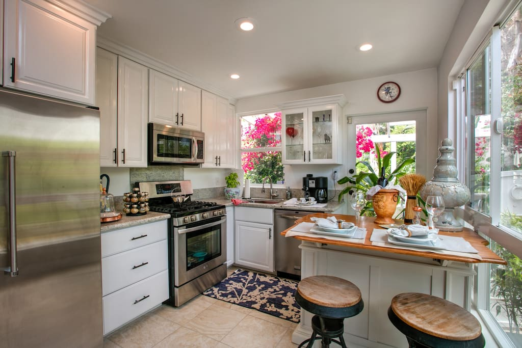 Stunning and functional, the kitchen features granite countertops for plenty of prep space.