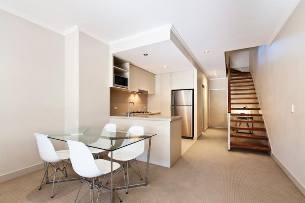 open plan kitchen to dining area, with private bedroom upstairs