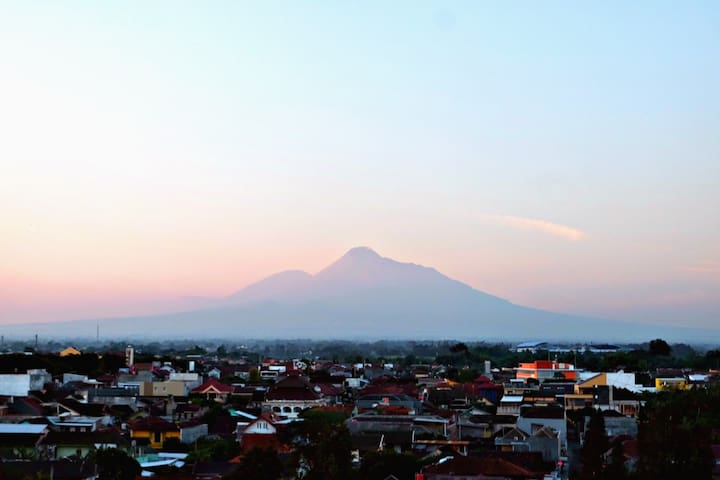 On clear days, you can see the Mount Merapi from the room's window and private balcony