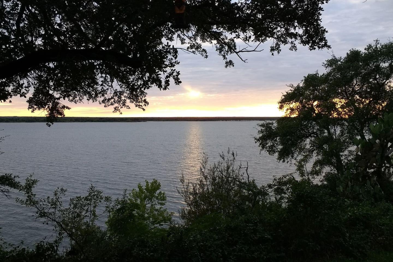 Enjoy breathtaking views of Lake Whitney every night at Sunset Retreat.